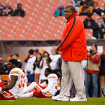 Kansas City Chiefs head coach Romeo Crennel walks amongst his players before an NFL football game against the Cleveland Browns in Cleveland, Sunday, Dec. 9, 2012. (AP Photo/Rick Osentoski)