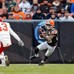 Cleveland Browns wide receiver Travis Benjamin cuts away from Kansas City Chiefs long snapper Thomas Gafford (43) on a 93-yard punt return for a touchdown in the second quarter of an NFL foo …