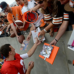 Browns' quarterback Johnny Manziel is inundated by admiring Brown's fans after the scrimmage game on Aug. 2. KRISTIN BAUER | CHRONICLE