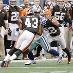 Dallas Cowboys wide receiver Kevin Ogletree (85) is tackled by Cleveland Browns strong safety T.J. Ward (43) and Cleveland Browns cornerback Buster Skrine (22) during the second half of an N …