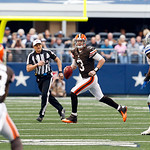 Cleveland Browns quarterback Brandon Weeden (3) looks to pass the ball to Cleveland Browns wide receiver Josh Gordon (13) as Dallas Cowboys nose tackle Jay Ratliff (90) defends second half o &#8230;