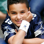 A young Dallas Cowboys fan poses for a photo during the first half of an NFL football game against the Cleveland Browns Sunday, Nov. 18, 2012 in Arlington, Texas. (AP Photo/Sharon Ellman)