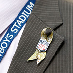 A Dallas Cowboys official wears a &quot;Salute to Service&quot; lapel ribbon during the first half of an NFL football game against the Cleveland Browns Sunday, Nov. 18, 2012 in Arlington, Texas. (AP P &#8230;