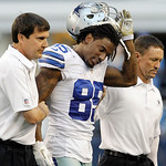 Dallas Cowboys trainers help Dallas Cowboys wide receiver Kevin Ogletree (85) off the field during the second half of an NFL football game agains the Cleveland Browns Sunday, Nov. 18, 2012 i …