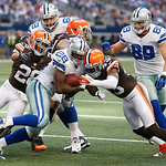 Dallas Cowboys running back Felix Jones (28) looks for room against Cleveland Browns strong safety T.J. Ward (43) during the second half of an NFL football game Sunday, Nov. 18, 2012 in Arli …