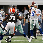 Dallas Cowboys quarterback Tony Romo (9) looks to throw the ball as Cleveland Browns defensive tackle Ahtyba Rubin (71) defends during the first half of an NFL football game Sunday, Nov. 18, …