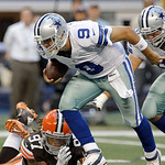 Cleveland Browns defensive end Jabaal Sheard (97) attempts to bring down Dallas Cowboys quarterback Tony Romo (9) as Dallas Cowboys tackle Doug Free (68) looks on during the second half of a …