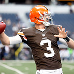 Cleveland Browns quarterback Brandon Weeden (3) throws pass during warmups before the first half of an NFL football game against the Dallas Cowboys Sunday, Nov. 18, 2012 in Arlington, Texas. …