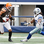 Cleveland Browns punt returner Josh Cribbs (16) looks for room against Dallas Cowboys wide receiver Dwayne Harris (17) during the second half of an NFL football game Sunday, Nov. 18, 2012 in …