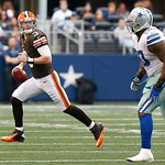Cleveland Browns quarterback Brandon Weeden (3) looks to pass the ball as Dallas Cowboys nose tackle Jay Ratliff defends during the second half of an NFL football game Sunday, Nov. 18, 2012  …