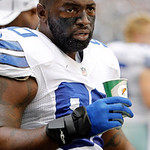 Dallas Cowboys nose tackle Jay Ratliff (90) rehydrates on the sidelines during the first half of an NFL football game against the Cleveland Browns Sunday, Nov. 18, 2012 in Arlington, Texas.  …