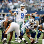 Dallas Cowboys quarterback Tony Romo (9) signals his teammates during the second half of an NFL football game against the Cleveland Browns Sunday, Nov. 18, 2012 in Arlington, Texas. (AP Phot …