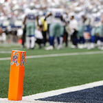 "A NFL end zone pylon displays a ""Salute to Service"" camouflage ribbon honoring military service member  first half of an NFL football game Sunday, Nov. 18, 2012 in Arlington, Texas. (AP Phot …"