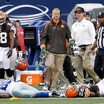 Dallas Cowboys wide receiver Kevin Ogletree (85) and Cleveland Browns cornerback Buster Skrine (22) lay motionless on the field after colliding during the second half of an NFL football game …