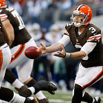 Cleveland Browns quarterback Brandon Weeden (3) tosses the ball to a teammate during the second half of an NFL football game against the Dallas Cowboys Sunday, Nov. 18, 2012 in Arlington, Te …