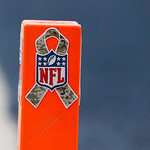 "An NFL pylon is decorated with a ""Salute to Service"" ribbon during the second half of an NFL football game Sunday, Nov. 18, 2012 in Arlington, Texas. (AP Photo/Sharon Ellman)"
