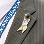 "A Dallas Cowboys official wears a ""Salute to Service"" lapel ribbon during the first half of an NFL football game against the Cleveland Browns Sunday, Nov. 18, 2012 in Arlington, Texas. (AP P …"