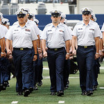 "Members of the Coast Guard march onto the field during a ""Salute to Service"" halftime show in an NFL football game between the Dallas Cowboys and Cleveland Browns Sunday, Nov. 18, 2012 in Ar …"