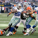 Dallas Cowboys running back Felix Jones (28) looks for room against Cleveland Browns middle linebacker D'Qwell Jackson (52), Cleveland Browns defensive end Jabaal Sheard (97) and Cleveland B …
