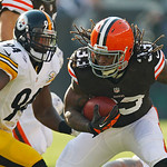 Cleveland Browns running back Trent Richardson (33) runs against Pittsburgh Steelers linebacker Lawrence Timmons (94) in the first quarter of an NFL football game Sunday, Nov. 25, 2012, in C …
