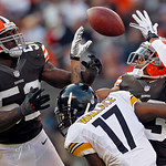 Cleveland Browns linebacker D'Qwell Jackson (52) and cornerback Joe Haden break up a pass to Pittsburgh Steelers wide receiver Mike Wallace (17) in the fourth quarter of an NFL football game …
