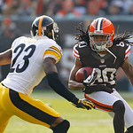Cleveland Browns wide receiver Travis Benjamin (80) tries to avoid Pittsburgh Steelers cornerback Keenan Lewis (23) during an NFL football game Sunday, Nov. 25, 2012, in Cleveland. (AP Photo …