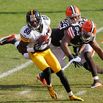 Pittsburgh Steelers wide receiver Emmanuel Sanders (88) makes a catch against Cleveland Browns linebacker Craig Robertson (53) and cornerback Buster Skrine (22) in the second quarter of an N …