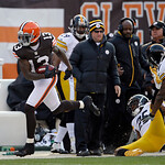Cleveland Browns wide receiver Josh Gordon (13) isforced out of bounds by Pittsburgh Steelers safety Ryan Clark and cornerback Ike Taylor (24) after a long pass in the first quarter of an NF …