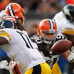 Cleveland Browns defensive tackle Billy Winn (90) intercepts a tipped pass against the Pittsburgh Steelers in the fourth quarter of an NFL football game Sunday, Nov. 25, 2012, in Cleveland.  …