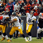 Pittsburgh Steelers quarterback Charlie Batch (16) passes under pressure from Cleveland Browns defensive tackle Phillip Taylor, right, in the fourth quarter of an NFL football game Sunday, N …