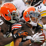 Cleveland Browns cornerback Tashaun Gipson (39) grabs Joe Haden after Haden's fourth quarter interception against the Pittsburgh Steelers in an NFL football game Sunday, Nov. 25, 2012, in Cl …