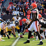 Cleveland Browns center Alex Mack, center right, prepares to snap the ball against the Pittsburgh Steelers in the first half of an NFL football game Sunday, Nov. 25, 2012, in Cleveland. (AP  …