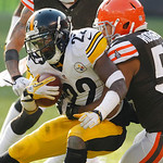 Pittsburgh Steelers running back Chris Rainey (22) is tackled by Cleveland Browns linebacker Craig Robertson (53) during an NFL football game Sunday, Nov. 25, 2012, in Cleveland. (AP Photo/T …