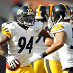 Pittsburgh Steelers linebacker Lawrence Timmons (94) is congratulated by linebacker Larry Foote (50) after Timmons returned an interception for a touchdown against the Cleveland Browns in th …