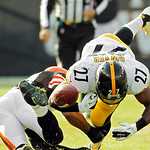 Pittsburgh Steelers running back Jonathan Dwyer (27) fumbles on a hit by Cleveland Browns safety T.J. Ward in the second quarter of an NFL football game Sunday, Nov. 25, 2012, in Cleveland.  …