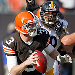 Cleveland Browns quarterback Brandon Weeden (3) is chased by Pittsburgh Steelers defensive end Brett Keisel (99) in the first quarter of an NFL football game Sunday, Nov. 25, 2012, in Clevel …