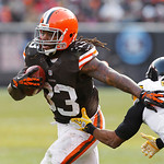 Cleveland Browns running back Trent Richardson (33) runs past Pittsburgh Steelers safety Will Allen (26) in the third quarter of an NFL football game Sunday, Nov. 25, 2012, in Cleveland. (AP …