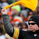 A Pittsburgh Steelers fan waves his terrible towel in the first quarter of an NFL football game between the Steelers and Cleveland Browns Sunday, Nov. 25, 2012, in Cleveland. (AP Photo/Ron S …