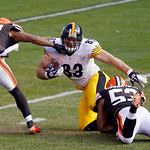 Cleveland Browns defensive back Buster Skrine (22) and Cleveland Browns linebacker Craig Robertson (53) tackle Pittsburgh Steelers tight end Heath Miller (83) during an NFL football game Sun …