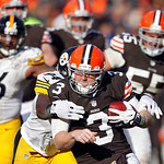 Cleveland Browns quarterback Brandon Weeden (3) is taken down by Pittsburgh Steelers linebacker Lawrence Timmons in the second quarter of an NFL football game Sunday, Nov. 25, 2012, in Cleve …