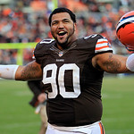 Cleveland Browns defensive lineman Billy Winn celebrates after the Browns won 20-14 in an NFL football game against the Pittsburgh Steelers Sunday, Nov. 25, 2012, in Cleveland. (AP Photo/Ton …