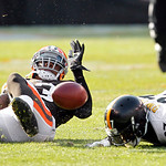 Pittsburgh Steelers running back Jonathan Dwyer (27) fumbles after a hit by Cleveland Browns safety T.J. Ward, left, in the second quarter of an NFL football game Sunday, Nov. 25, 2012, in C …