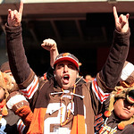 A Cleveland Browns fan celebrates during an NFL football game against the Pittsburgh Steelers Sunday, Nov. 25, 2012, in Cleveland. (AP Photo/Tony Dejak)