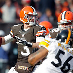 Cleveland Browns quarterback Brandon Weeden passes against the Pittsburgh Steelers in the first quarter of an NFL football game Sunday, Nov. 25, 2012, in Cleveland. (AP Photo/Ron Schwane)