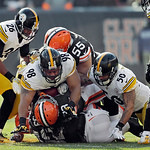 Pittsburgh Steelers nose tackle Casey Hampton (98), linebacker Larry Foote (50) and safety Will Allen (26) combine to stop Cleveland Browns running back Trent Richardson on a first quarter r …