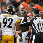 Umpire Carl Paganelli (124) steps between Pittsburgh Steelers linebacker James Harrison (92) and Cleveland Browns guard John Greco in the fourth quarter of an NFL football game Sunday, Nov.  …