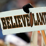 A Cleveland Browns fan holds a sign in the fourth quarter of a 200-14 win over the Pittsburgh Steelers in an NFL football game Sunday, Nov. 25, 2012, in Cleveland. (AP Photo/Tony Dejak)