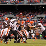 Cleveland Browns quarterback Brandon Weeden (3) passes the ball as Baltimore Ravens defensive end Haloti Ngata (92) pressures him in the second half of an NFL football game in Cleveland, Sun …