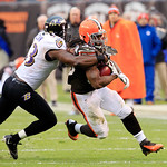 Cleveland Browns running back Trent Richardson, right, is tackled by Baltimore Ravens inside linebacker Jameel McClain during an NFL football game Sunday, Nov. 4, 2012, in Cleveland. (AP Pho …