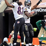 Baltimore Ravens running back Bernard Pierce, right, celebrates his 12-yard touchdown run with wide receiver Torrey Smith in the first quarter of an NFL football game against the Cleveland B …